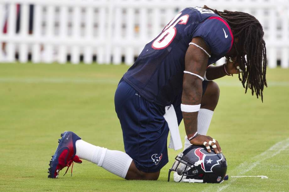 Texans safety D.J. Swearinger kneels down to pray before the start of the third day of training camp. Photo: Brett Coomer, Houston Chronicle