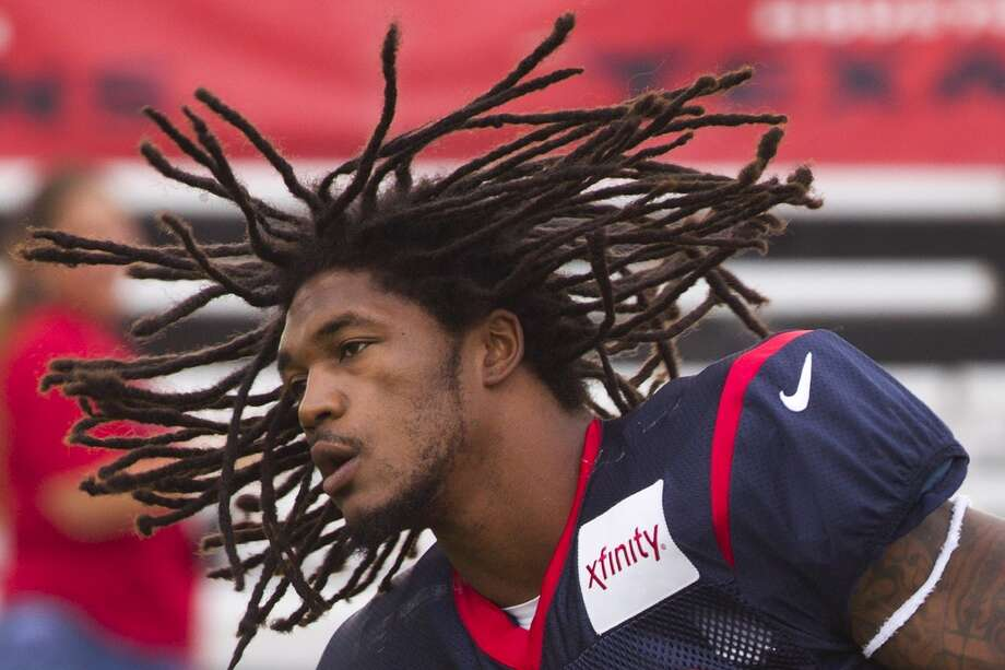 Texans safety D.J. Swearinger jogs onto the field for the third day of training camp. Photo: Brett Coomer, Houston Chronicle