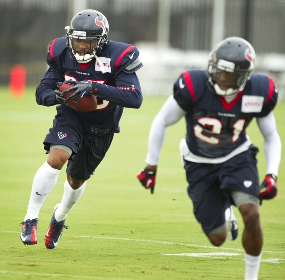 Texans defensive back Eddie Pleasant intercepts a pass during training camp drills. Photo: Brett Coomer, Houston Chronicle