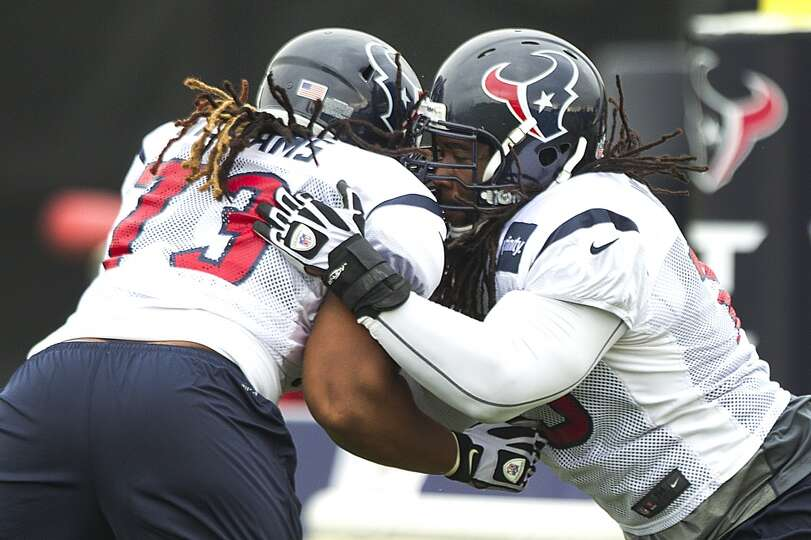 Brennan Williams and Derek Newton compete in a drill during Texans training camp.