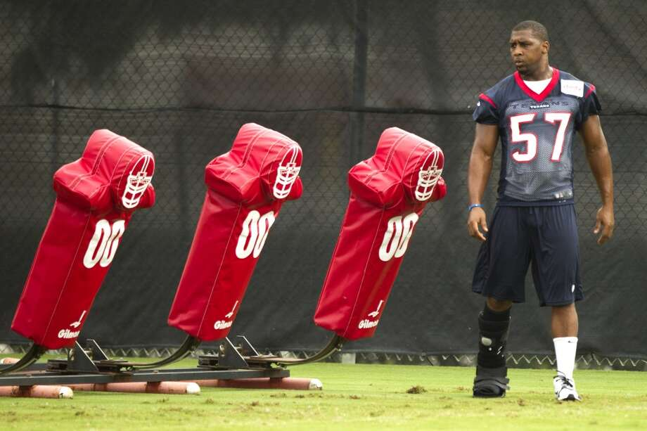 Injured linebacker Sam Montgomery watches the action at training camp. Photo: Brett Coomer, Houston Chronicle