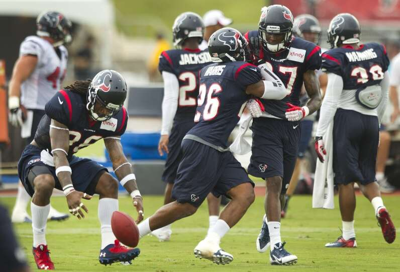 Texans safety D.J. Swearinger recovers a loose ball during a turnover drill at training camp.
