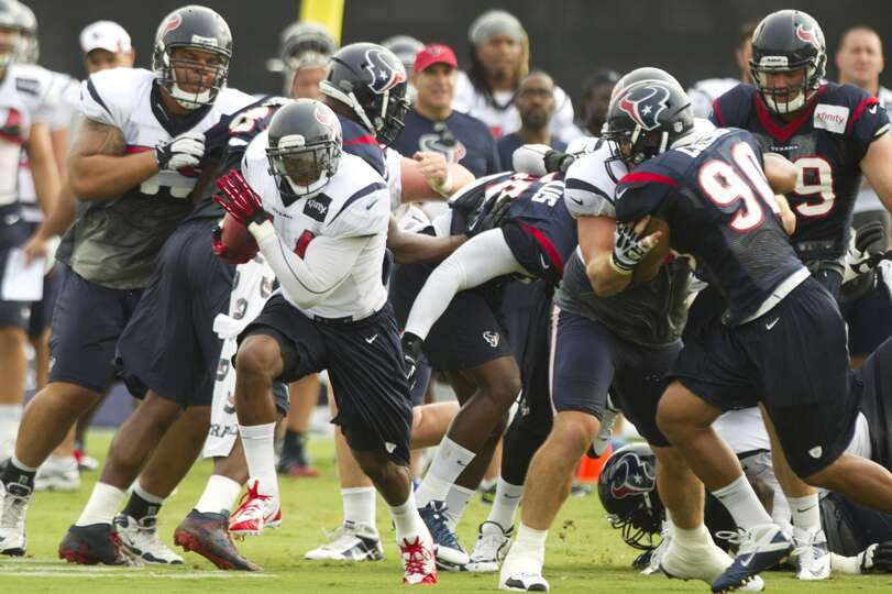 Texans running back Ben Tate attempts a carry during training camp.