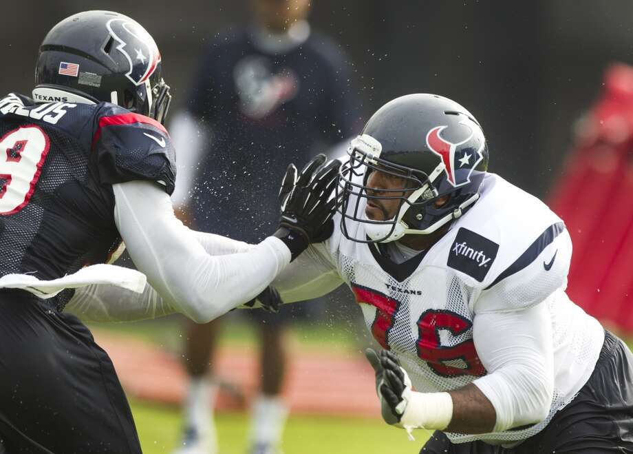 Texans linebacker Whitney Mercilus and offensive lineman Duane Brown participate in a drill at training camp. Photo: Brett Coomer, Houston Chronicle