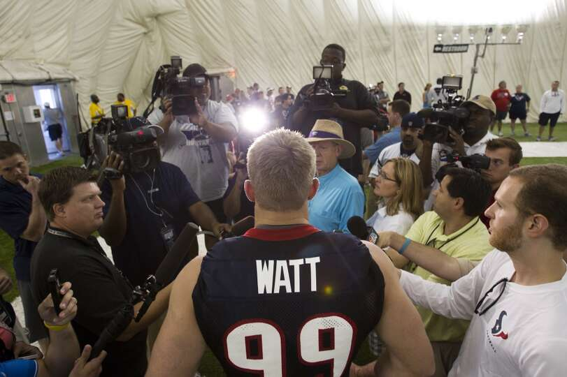 Texans defensive end J.J. Watt speaks with the media