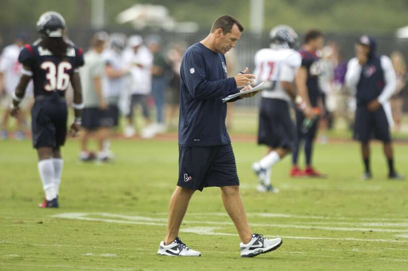 Texans coach Gary Kubiak monitors training camp activities.