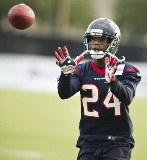 Texans cornerback Johnathan Joseph reaches out to catch a ball.