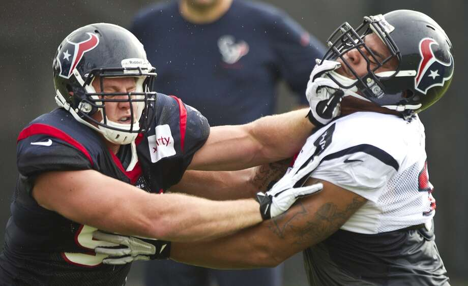 Texans defensive end J.J. Watt (99) rushes the passer against guard Brandon Brooks (79). Photo: Brett Coomer, Houston Chronicle