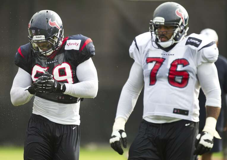 Texans outside linebacker Whitney Mercilus (59) reacts after going up against tackle Duane Brown (76