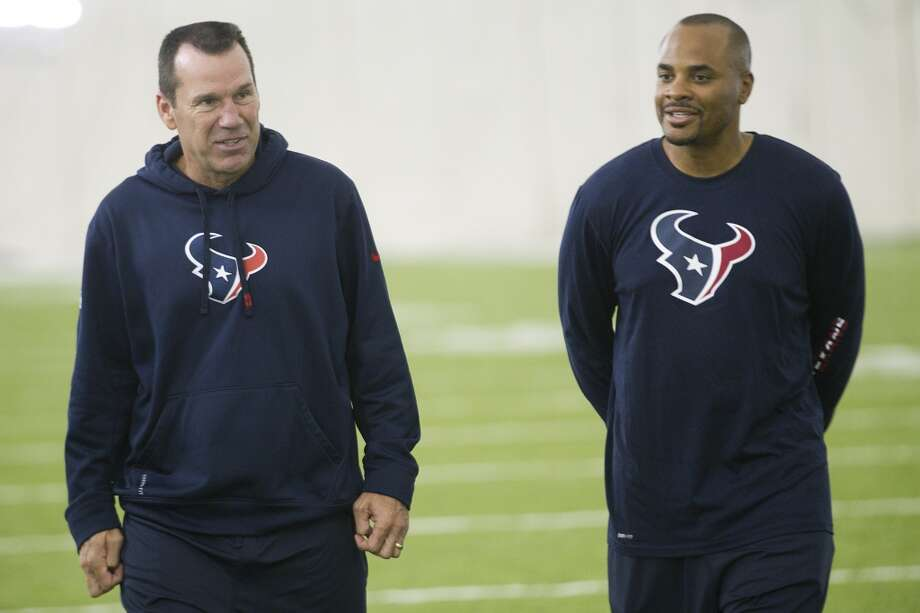 Texans head coach Gary Kubiak, left, and general manager Rick Smith walk off the field at the end of practice. Photo: Brett Coomer, Houston Chronicle