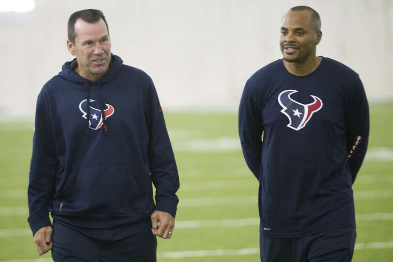 Texans head coach Gary Kubiak, left, and general manager Rick Smith walk off the field at the end of