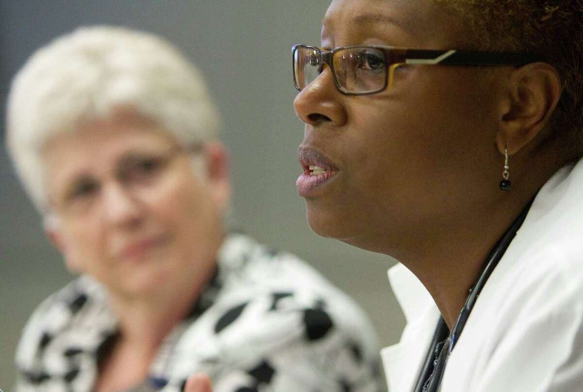 Karen Walters, left, a registered nurse, listens to Andrea Downey, a nurse practitioner, last week during Schwartz Center Rounds at Houston Methodist Hospital, where caregivers discuss job issues.