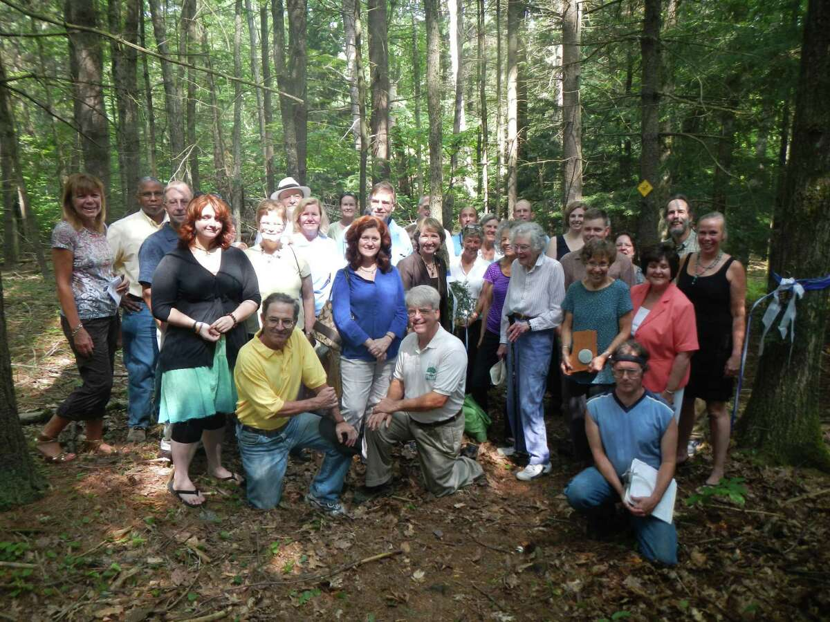 More than 30 community members gathered July 20 at Rensselaer Land Trust?s Robert Ingalls Preserve in Stephentown for a ribbon-cutting ceremony in memory of Ingalls, a long-time board member who served on committees to aid in the land trust's success. Ingalls Preserve is a permanently protected 30-acre property donated to land trust in 2010 by Barbara Goldberg of New York City. State Sen. Kathleen Marchione and County Executive Kathleen Jimino attended.