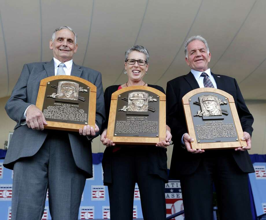 Family representatives Jerry Watkins, left, great grandson of Baseball Hall of Fame inductee Deacon White, Anne Vernon,center, great grandniece of inductee Jacob Ruppert, and Dennis McNamara, grandnephew of inductee Hank O'Day, hold the players' plaques after a ceremony on Sunday, July 28, 2013, in Cooperstown, N.Y. (AP Photo/Mike Groll) ORG XMIT: NYMG107 Photo: Mike Groll / AP