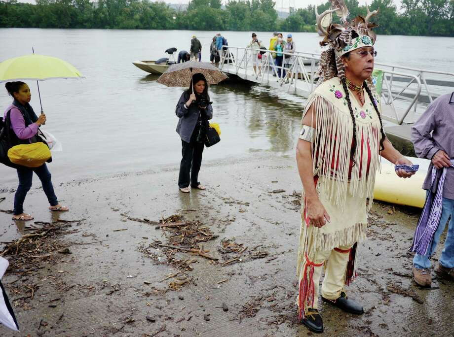 Tadodaho Sid Hill, Spiritual Leader of the Haudenosaunee (Six Nations/Iroquois Confederacy) addresses people taking part in the flotilla of canoes and kayaks as they start their trip down the Hudson River to New York City on Sunday, July 28, 2013 in Rensselaer, NY.  The trip is being held to commemorate the 400th anniversary of the first treaty between Europeans and Indians, the Two Row Wampum treaty between the Dutch and the Haudenosaunee Confederacy of Six Nations.  The group of paddlers plan to arrive in New York City on August 9th.     (Paul Buckowski / Times Union) Photo: Paul Buckowski / 00023315A