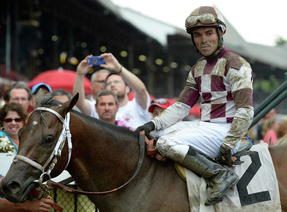 Forty Tales with jockey Joel Rosario stands in the winner's circle after winning the 21st running of The Amsterdam July 28, 2013 at the Saratoga Race Course in Saratoga Springs, N.Y.   (Skip Dickstein/Times Union) Photo: SKIP DICKSTEIN