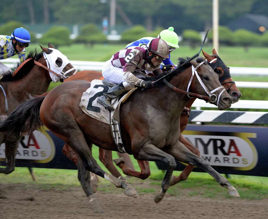 Forty Tales with jockey Joel Rosario passes the field to win the 21st running of The Amsterdam July 28, 2013 at the Saratoga Race Course in Saratoga Springs, N.Y.   (Skip Dickstein/Times Union) Photo: SKIP DICKSTEIN