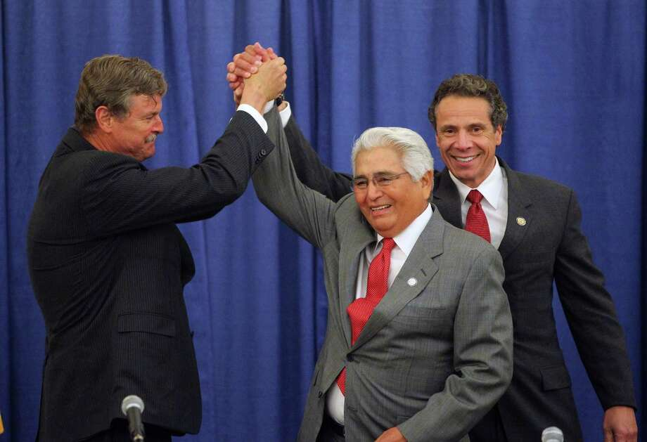 Niagara Falls Mayor Paul Dyster, left, shakes with New York Governor Andrew Cuomo, right, and Seneca Nation President Barry Snyder before they signed an agreement after a long dispute about casino revenue sharing in Niagara Falls, N.Y. Thursday, June 13, 2013.  (AP Photo/The Buffalo News, Mark Mulville) TV OUT; MAGS OUT; MANDATORY CREDIT; BATAVIA DAILY NEWS OUT; DUNKIRK OBSERVER OUT; JAMESTOWN POST-JOURNAL OUT; LOCKPORT UNION-SUN JOURNAL OUT; NIAGARA GAZETTE OUT; OLEAN TIMES-HERALD OUT; SALAMANCA PRESS OUT; TONAWANDA NEWS OUT Photo: MARK MULVILLE / The Buffalo News
