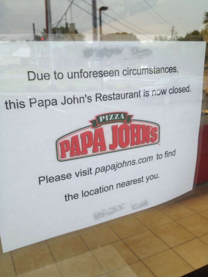 "A sign in the Papa John's Loudonville location at the corner of Everett and Albany Shaker Roads said the closure was ""due to unforeseen circumstances."" (Paul Grondahl / Times Union)"