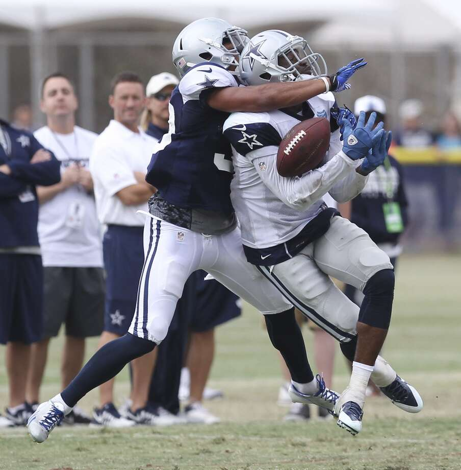 Cornerback Devin Smith (left) commits pass interference against receiver Tim Benford during practice and the Blue-White scrimmage at the 2013 Dallas Cowboys training camp on Sunday, July 28, 2013 in Oxnard, Calif. (Kin Man Hui / San Antonio Express-News) Photo: Kin Man Hui, San Antonio Express-News