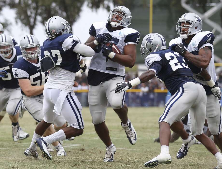 Tight end Andre Smith (87) gets hit by safety J.J. Wilcox (27) during practice and the Blue-White scrimmage at the 2013 Dallas Cowboys training camp on Sunday, July 28, 2013 in Oxnard, Calif. (Kin Man Hui / San Antonio Express-News) Photo: Kin Man Hui, San Antonio Express-News