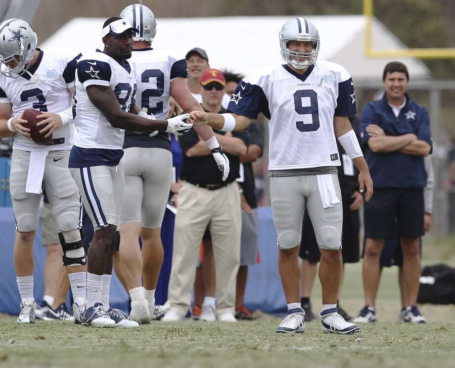Quarterback Tony Romo (09) gets congratulated by receiver Dez Bryant (88) after a successful play during practice and the Blue-White scrimmage at the 2013 Dallas Cowboys training camp on Sunday, July 28, 2013 in Oxnard, Calif. (Kin Man Hui / San Antonio Express-News) Photo: Kin Man Hui, San Antonio Express-News