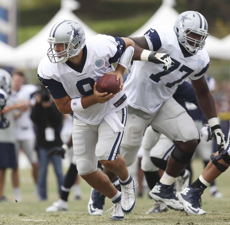 Quarterback Tony Romo looks to hand off the ball during practice and the Blue-White scrimmage at the 2013 Dallas Cowboys training camp on Sunday, July 28, 2013 in Oxnard, Calif. (Kin Man Hui / San Antonio Express-News) Photo: Kin Man Hui, San Antonio Express-News