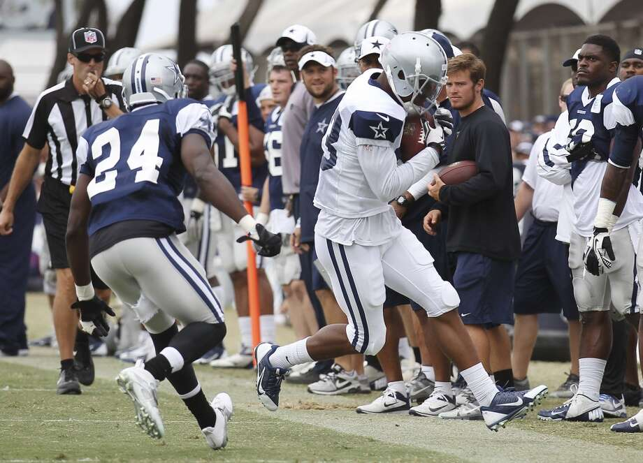 Receiver Terrance Williams (83) runs out of bounds against cornerback Morris Claiborne (24) during practice and the Blue-White scrimmage at the 2013 Dallas Cowboys training camp on Sunday, July 28, 2013 in Oxnard, Calif. (Kin Man Hui / San Antonio Express-News) Photo: Kin Man Hui, San Antonio Express-News