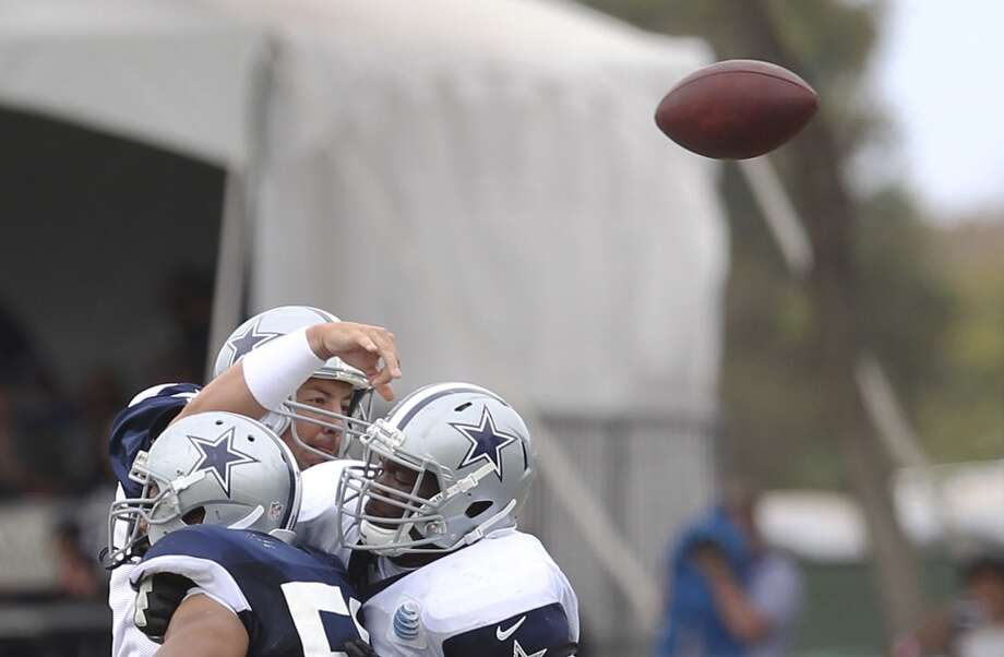 Quarterback Kyle Orton throws under pressure during practice and the Blue-White scrimmage at the 2013 Dallas Cowboys training camp on Sunday, July 28, 2013 in Oxnard, Calif. (Kin Man Hui / San Antonio Express-News) Photo: Kin Man Hui, San Antonio Express-News