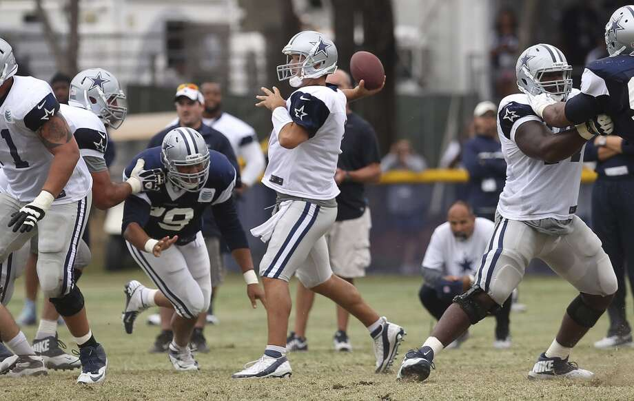 Quarterback Tony Romo attempts a pass during practice and the Blue-White scrimmage at the 2013 Dallas Cowboys training camp on Sunday, July 28, 2013 in Oxnard, Calif. (Kin Man Hui / San Antonio Express-News) Photo: Kin Man Hui, San Antonio Express-News
