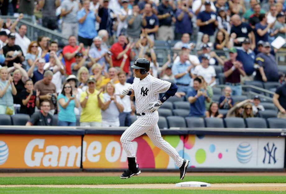 New York Yankees' Derek Jeter runs the bases after hitting a solo home run against the Tampa Bay Rays in a baseball game on Sunday, July 28, 2013, in New York. (AP Photo/Kathy Willens) ORG XMIT: NYY113 Photo: Kathy Willens / AP