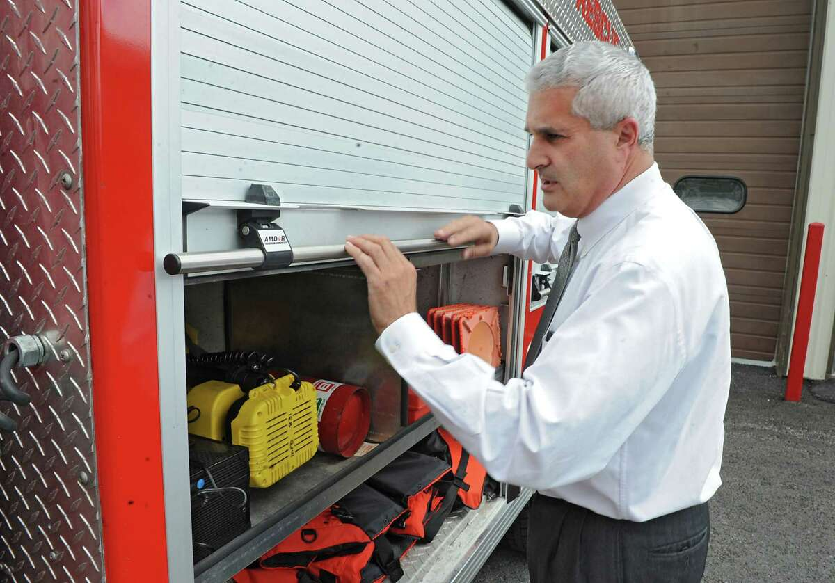 Fulton County Judge Richard Giardino closes the door on a rescue truck at the Mayfield firehouse where he is a volunteer firefighter on Friday, June 14, 2013 in Mayfield, N.Y. (Lori Van Buren / Times Union)