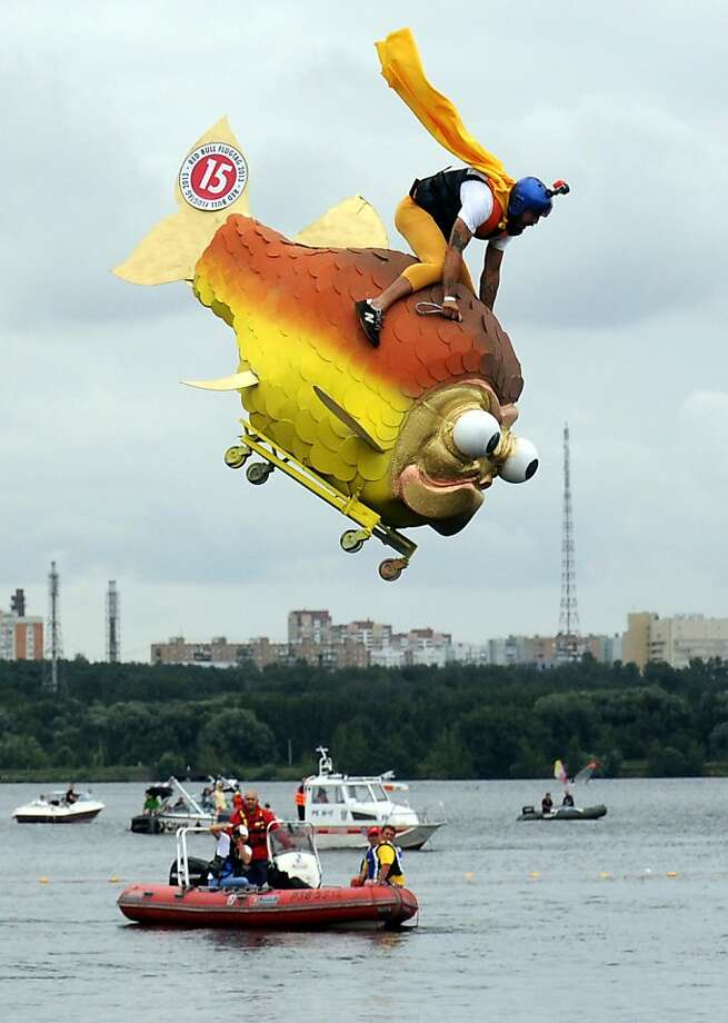 """In the likely event of a water landing ...A competitor rides his """"aircraft"""" into the   river on Red Bull Flugtag (Flying Day) in Moscow. Flugtag requires teams in fancy   costumes to pilot human-powered, home-made flying machines off a 6-meter-high platform   over water. Photo: Vasily Maximov, AFP/Getty Images"""