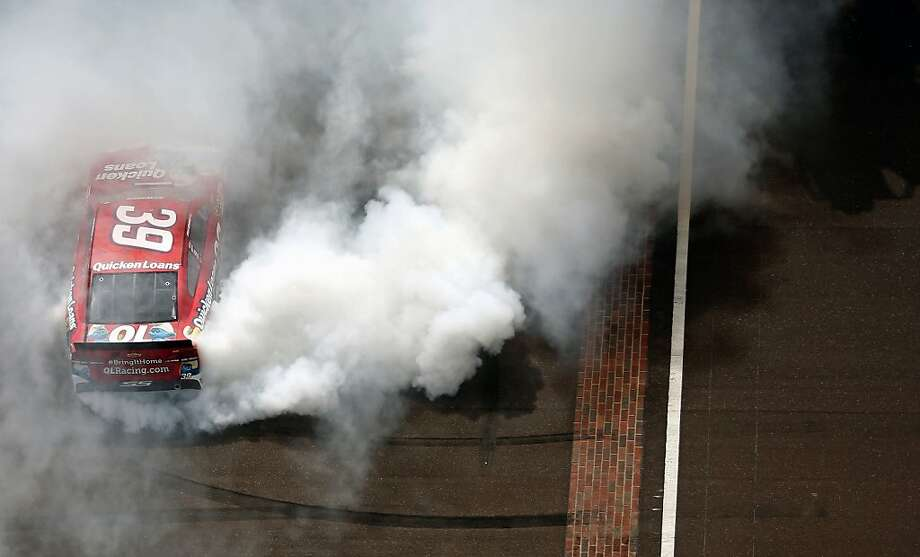Sprint Cup Series driver Ryan Newman celebrates with a burnout after winning the Brickyard 400 auto race at Indianapolis Motor Speedway on July 28, 2013m in Indianapolis. (AP Photo/NASCAR, Chris Graythen, Pool) Photo: Chris Graythen, Associated Press
