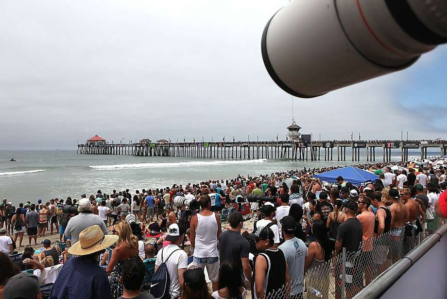Thousands gather at Huntington Beach pier as surfers compete in the Vans US Open of Surfing in Huntington Beach, California, Sunday, July 28 2013. (Brian van der Brug/Los Angeles Times/MCT) Photo: Brian Van Der Brug, McClatchy-Tribune News Service