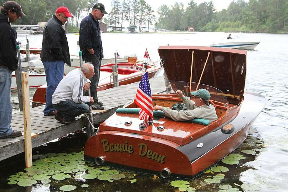 Despite rain showers, antique boats draw a large crowd Saturday, July 27, 2013 in Crosslake, Minn. during the Whitefish Chain Antique and Classic Wood Boat Rendezvous at Moonlite Bay. (AP Photo/Brainerd Dispatch, Kelly Humphrey) Photo: Kelly Humphrey, Associated Press