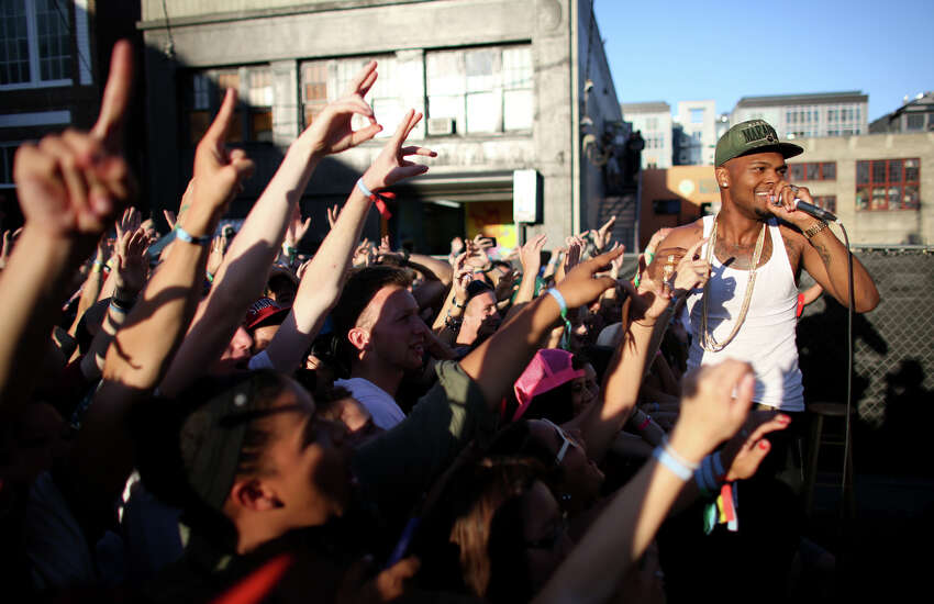 Rapper Raz Simone performs with Sam Lachow during the annual Capitol Hill Block Party on Sunday, July 28, 2013 in Seattle. The three day music festival wrapped up on Sunday.
