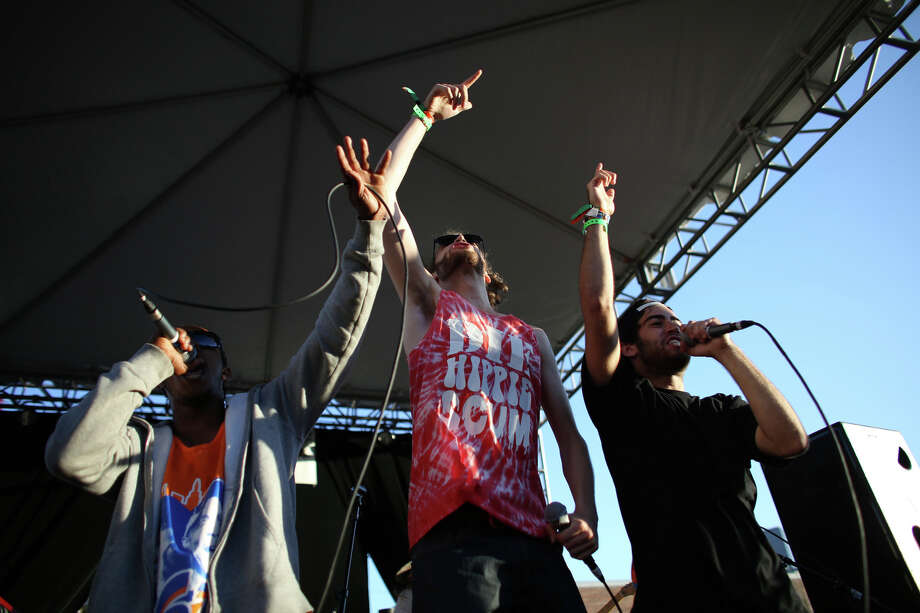 Rapper Sam Lachow, right, performs with others during the annual Capitol Hill Block Party on Sunday, July 28, 2013 in Seattle. The three day music festival wrapped up on Sunday. Photo: JOSHUA TRUJILLO, SEATTLEPI.COM / SEATTLEPI.COM