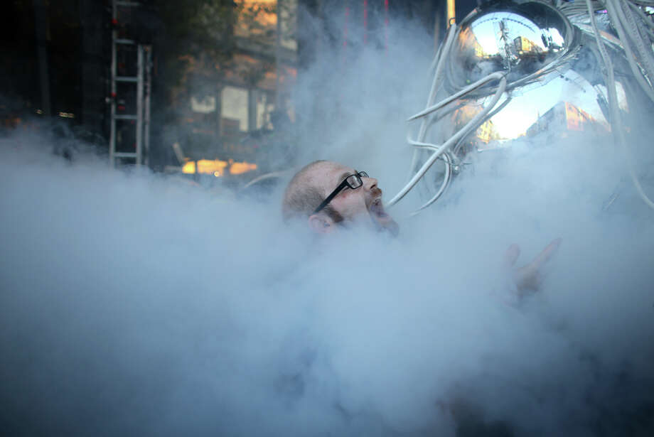 Photographer Dave Lichterman is engulfed in smoke from the main stage during the annual Capitol Hill Block Party on Sunday, July 28, 2013 in Seattle. The three day music festival wrapped up on Sunday. Photo: JOSHUA TRUJILLO, SEATTLEPI.COM / SEATTLEPI.COM