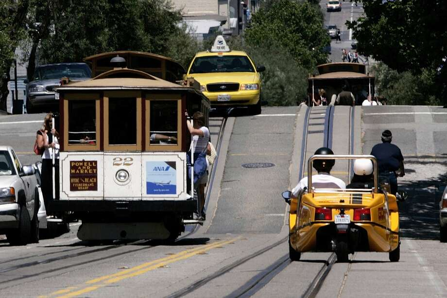 Rent a Go Car, be frightened by passing motorists  How can anyone be surprised that being in a knee-high, open-top, soap-box racer is scary in San Francisco traffic? Maybe tourists expect them to travel on a track? Perks of Go Cars include being dwarfed by powerful cars on dangerous streets, being exposed to the wind, and relying on an underpowered engine on steep hills. Photo: David Paul Morris, Getty Images