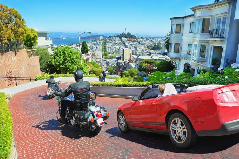 Go to the top of Lombard Street to take photos  The best views are at the bottom. Looking up catches the full crookedness of Lombard. Plus, the bottom also offers the best views of the poor tourists realizing halfway down that it's much more trouble than it's worth. Photo: Mitchell Funk, Getty Images