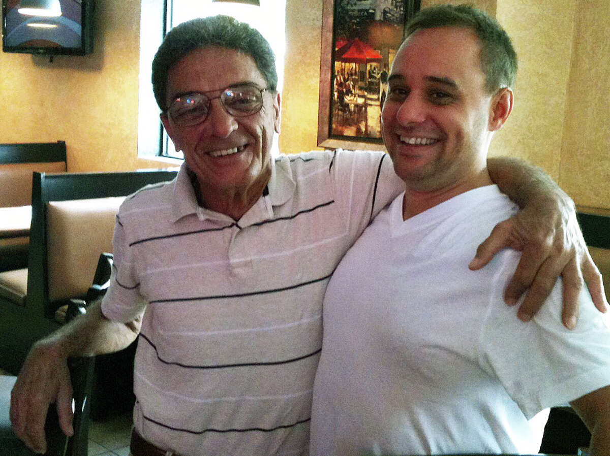 Leno D'Arcangelo, left, and David Cervero in Rocco's, a longtime pizzeria known as the Apizza Center that recently underwent major changes to its menu and interior. A planned grand reopening will take place in September. FAIRFIELD CITIZEN, CT 7/25/13