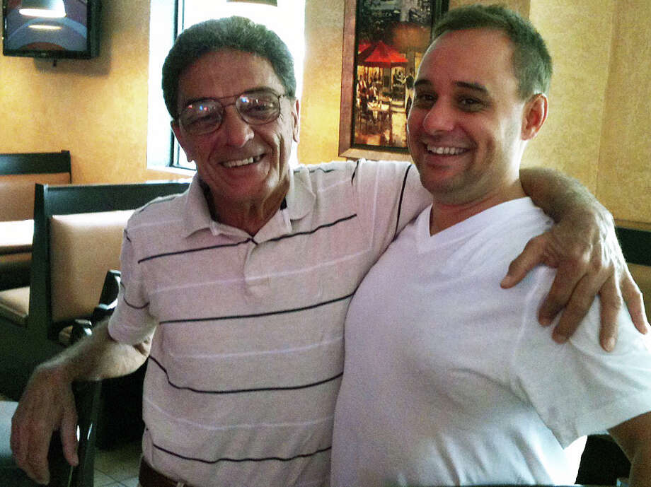 Leno D'Arcangelo, left, and David Cervero in Rocco's, a longtime pizzeria known as the Apizza Center that recently underwent major changes to its menu and interior. A planned grand reopening will take place in September.   FAIRFIELD CITIZEN, CT 7/25/13 Photo: Andrew Brophy / Fairfield Citizen contributed