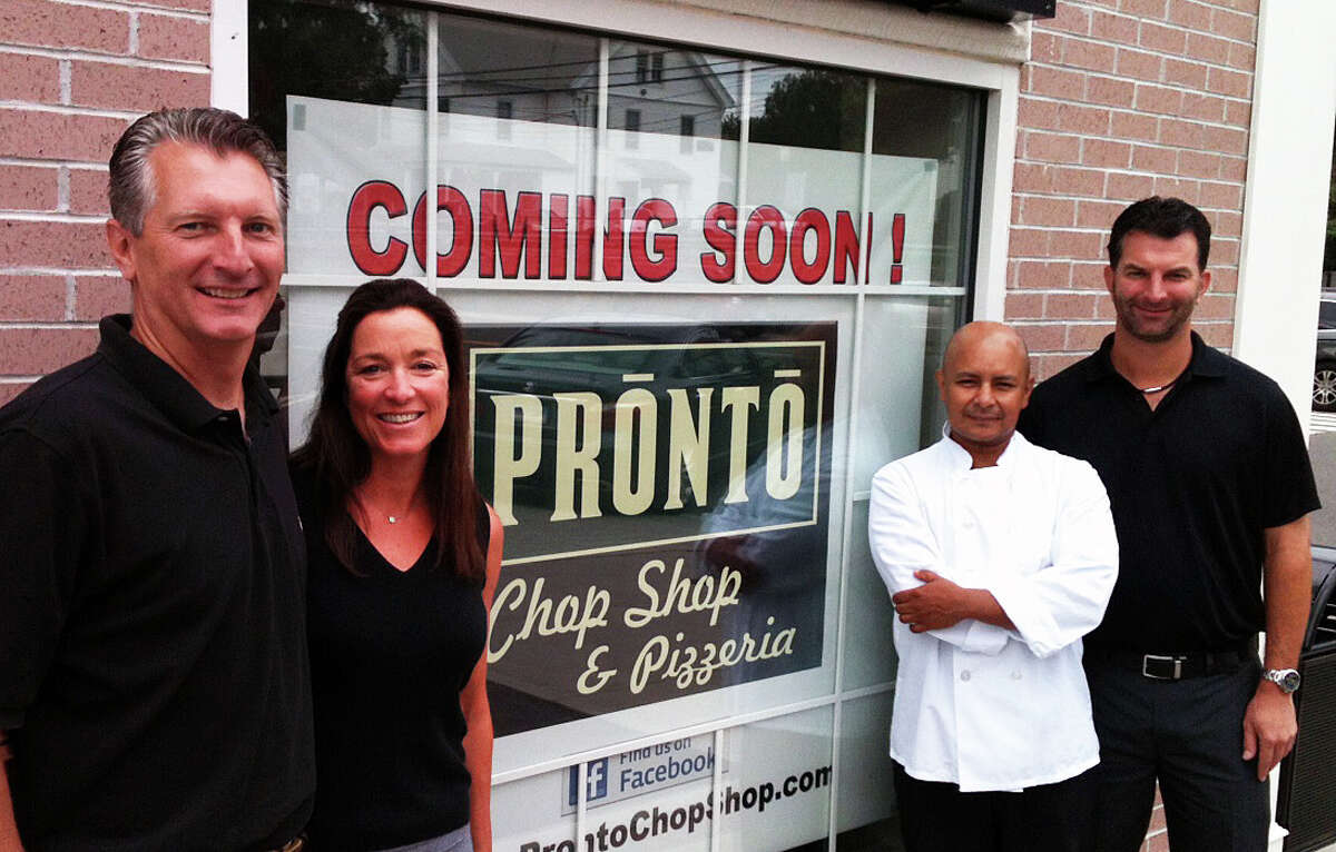 PRONTO Chop Shop & Pizzeria is tentatively scheduled to open Aug. 12. Pictured are partners in the Post Road restaurant, from left: Glenn Grella, Mary Grella, Nelson Martinez and Dave Grella. FAIRFIELD CITIZEN, CT 7/26/13