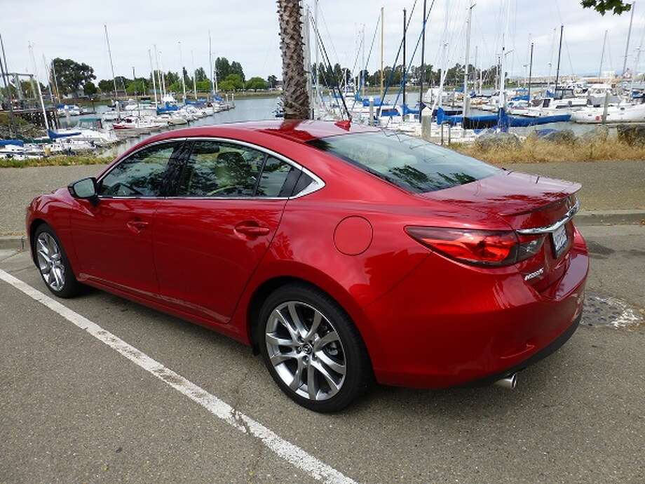 This year, the Mazda6, which has been around for 10 years, has a new look, with its cateye headlights and its complementary taillights. The car looks taut and whether that's a good thing is clearly in the eye of the beholder.