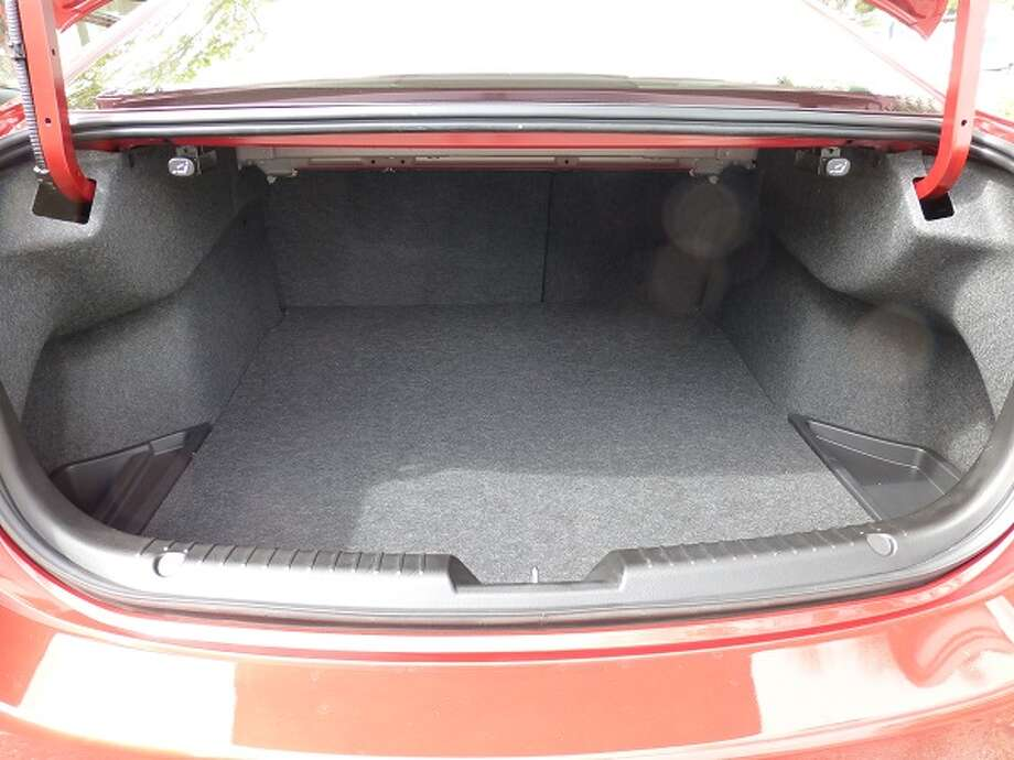 The trunk, with its 14.8 cubic feet of capacity, is about on a par with many of the other cars in the midsized segment.