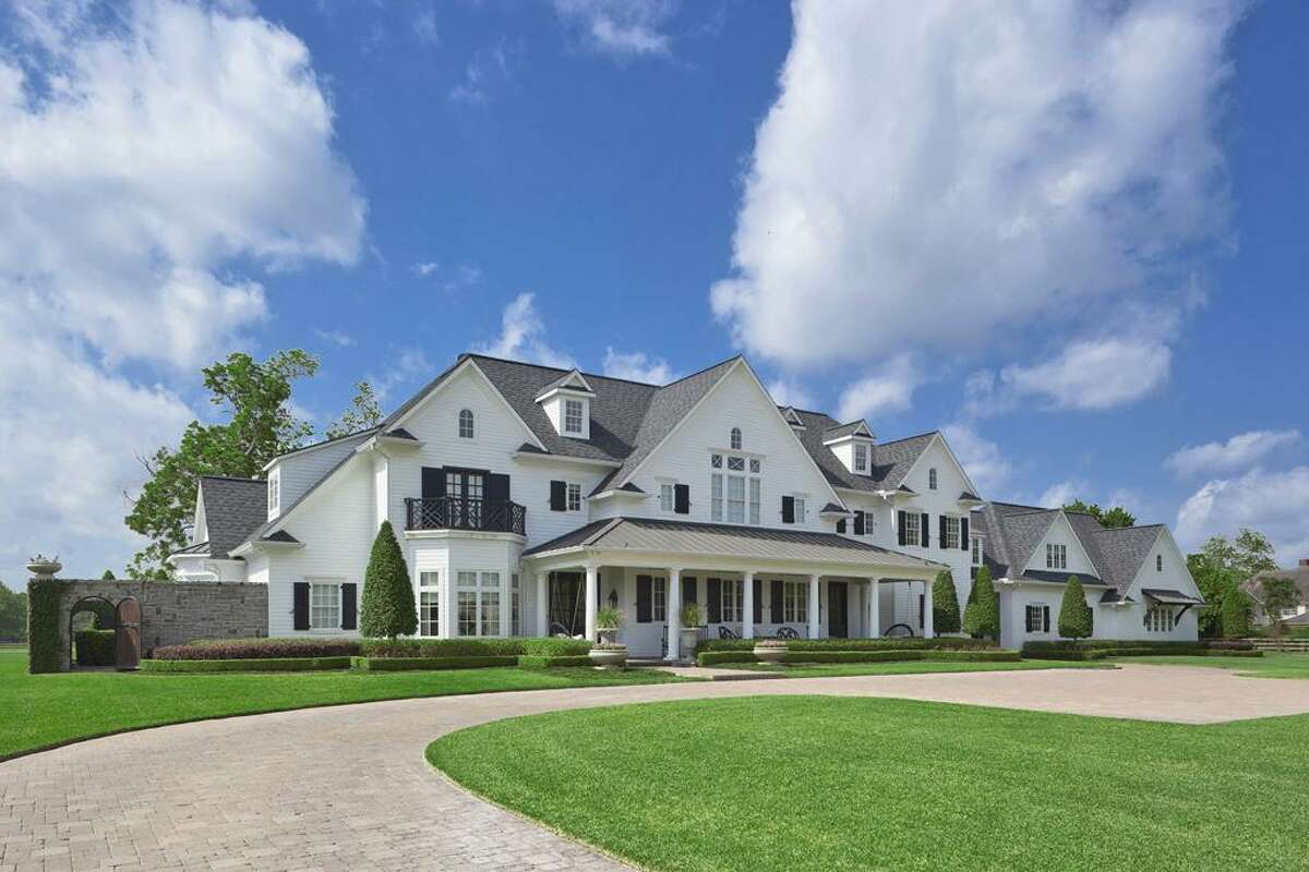 This English- and French-inspired home includes a baseball field, barn w/ 3 stalls-tack room-kitchen, outdoor entertaining area including fireplace- fire pit-pool, 4 car garage, circular drive, porte-cochere, elevator, third floor flex space, media room and gameroom.