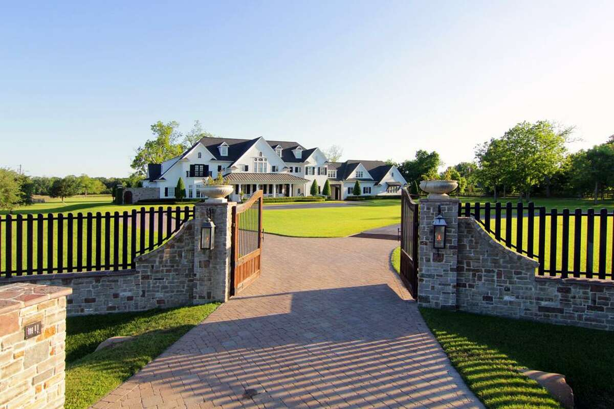 This custom-built gate gives visitors a distinguished welcome.