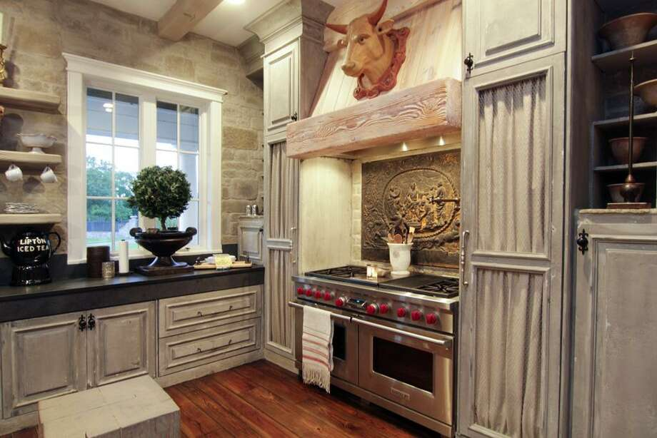 The kitchen decor includes a mixture of both antique and modern details.