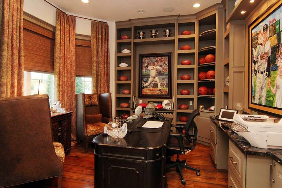The study featuring sports memorabilia collected by Shane Reynolds.